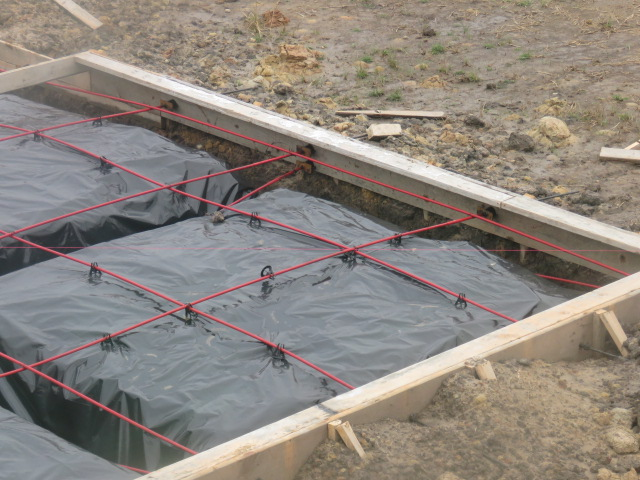 tendons in a foundation prepted for placement of concrete.